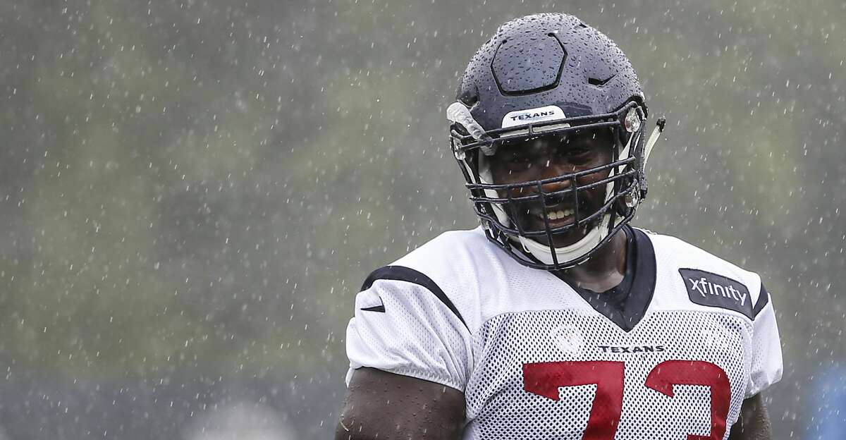 Houston Texans offensive guard Zach Fulton walks off the field at the end of practice in a steady rain during training camp at the Greenbrier Sports Performance Center on Friday, Aug. 3, 2018, in White Sulphur Springs, W.Va.