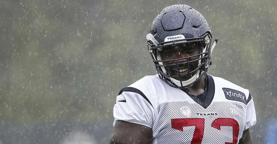 Houston Texans offensive guard Zach Fulton walks off the field at the end of practice in a steady rain during training camp at the Greenbrier Sports Performance Center on Friday, Aug. 3, 2018, in White Sulphur Springs, W.Va. Photo: Brett Coomer/Staff Photographer