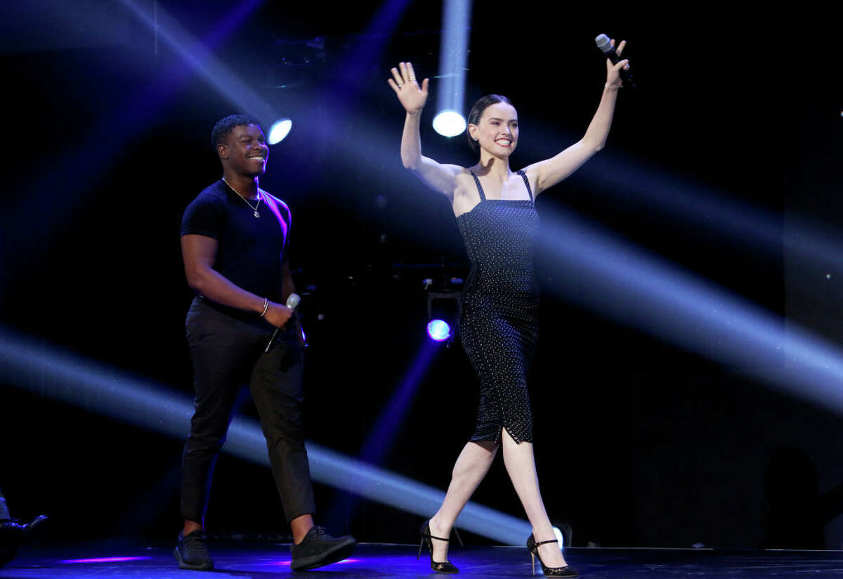 (L-R) John Boyega and Daisy Ridley of 'Star Wars: The Rise of Skywalker' took part today in the Walt Disney Studios presentation at Disney's D23 EXPO 2019 in Anaheim, Calif. 'Star Wars: The Rise of Skywalker' will be released in U.S. theaters on December 20, 2019.