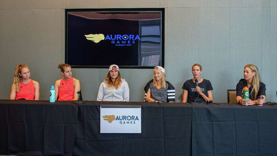Beach volley ball players from the U.S., the Czech Republic, Switzerland and Canada answer questions at the Albany Convention Center on Saturday, Aug. 24 prior to taking the sand on Sunday, Aug. 25 during the Aurora Games at the Times Union Center in Albany, NY (Jim Franco/Special to the Times Union.)4 Photo: James Franco / 20047681A