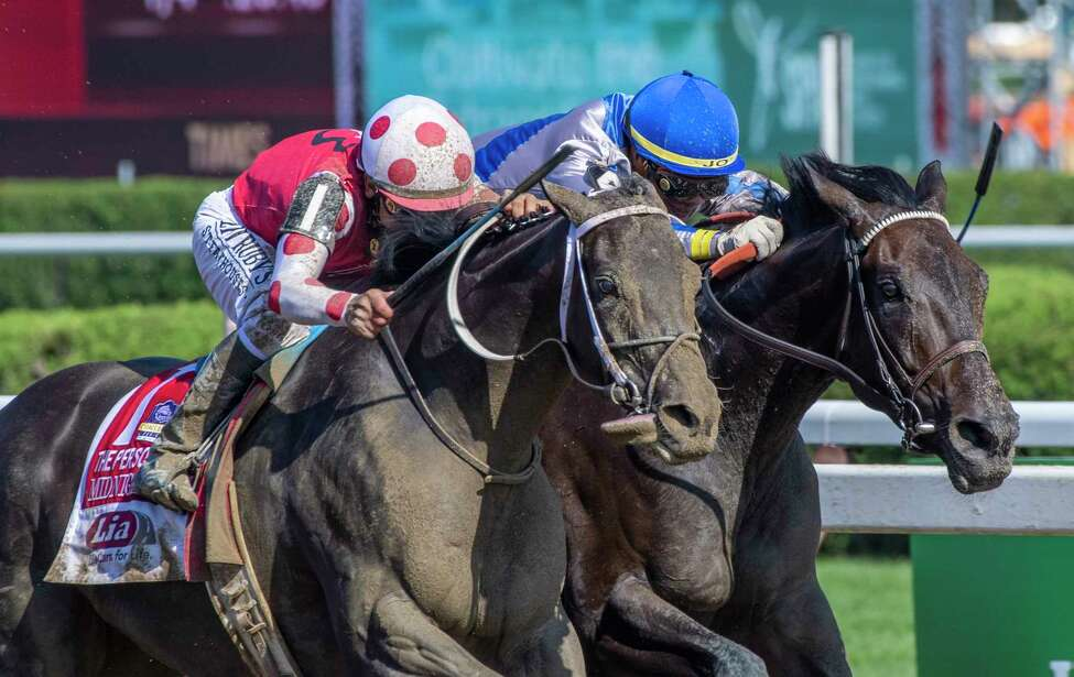 Midnight Bisou with jockey Mike Smith passes Elate ridden by Jose Ortiz to win The Personal Ensign presented by Lia Infiniti at the Saratoga Race Course Saturday Aug. 24, 2019 in Saratoga Springs, N.Y. Photo special to the Times Union by Skip Dickstein