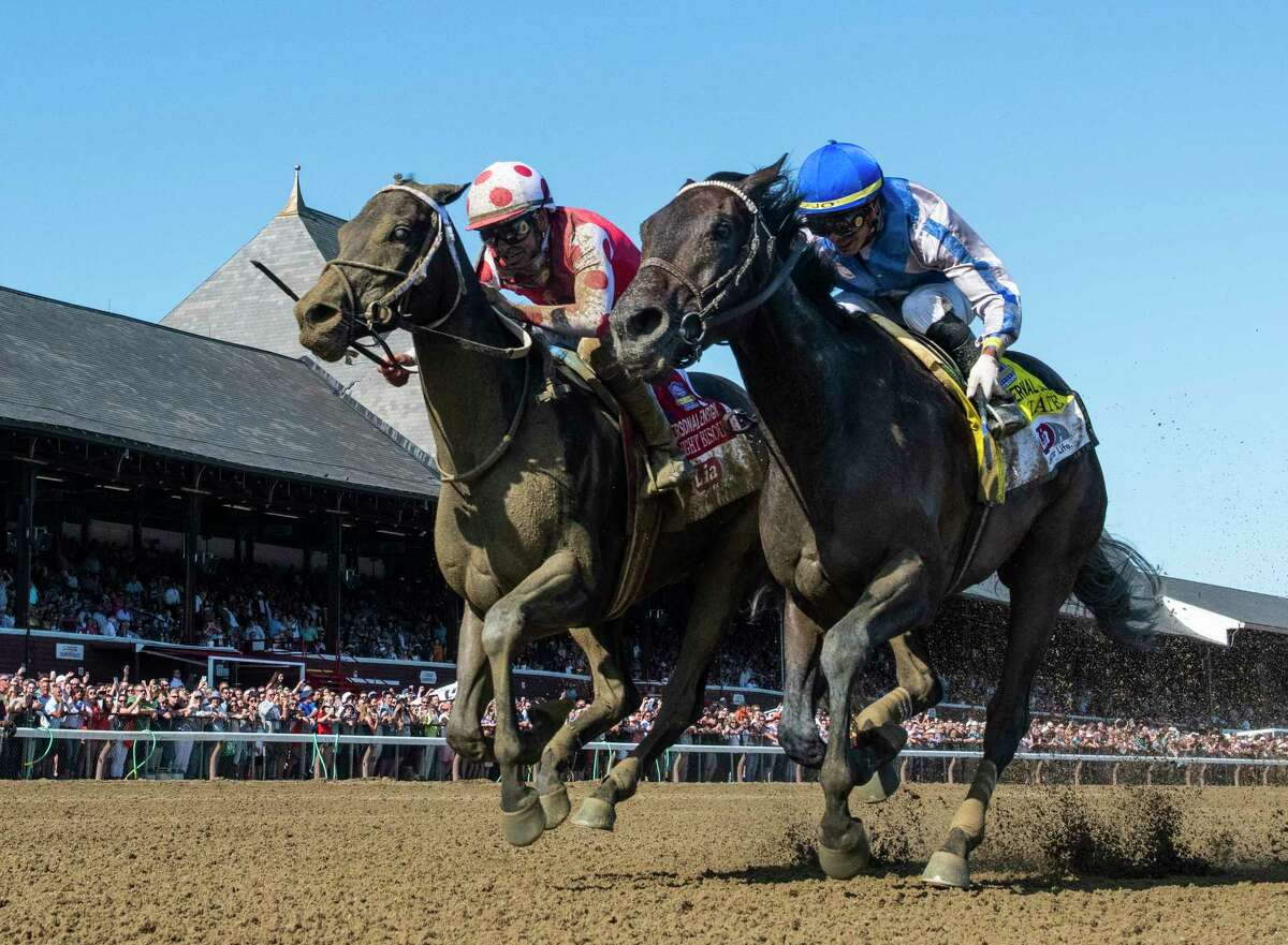 Midnight Bisou, left noses out Elate in the 72nd running of the Personal Ensign at the Saratoga Race Course Saturday Aug. 24, 2019 in Saratoga Springs, N.Y. Photo special to the Times Union by Skip Dickstein