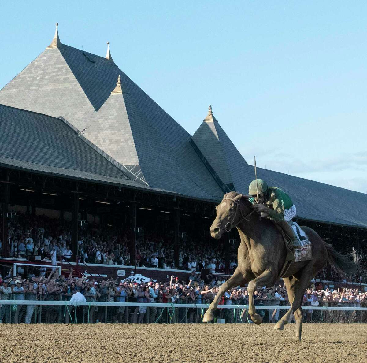 Code of Honor and jockey John Velazquez leads the way to the finish line and the win in the 150th running of the Travers Stakes at the Saratoga Race Course Saturday Aug. 24, 2019 in Saratoga Springs, N.Y. Photo special to the Times Union by Skip Dickstein