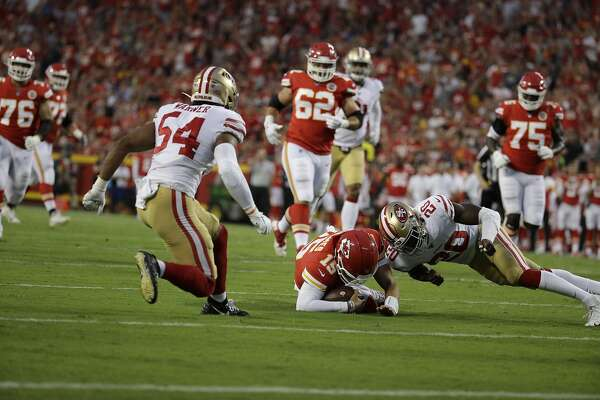 Kansas City Chiefs quarterback Patrick Mahomes (15) dives to avoid a tackle by San Francisco 49ers cornerback Jimmie Ward (20) during the first half of an NFL preseason football game in Kansas City, Mo., Saturday, Aug. 24, 2019. (AP Photo/Charlie Riedel)