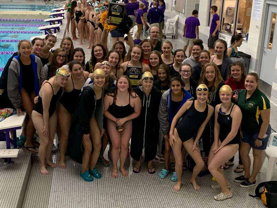 Dow High's swim team celebrates its first-place tie at the Battle Creek Relays on Saturday. Senior Claire Newman, who swam a pool-record 52.1 in her leg of the 400 freestyle relay, is holding the plaque above her head in the rear. Photo: Photo Provided