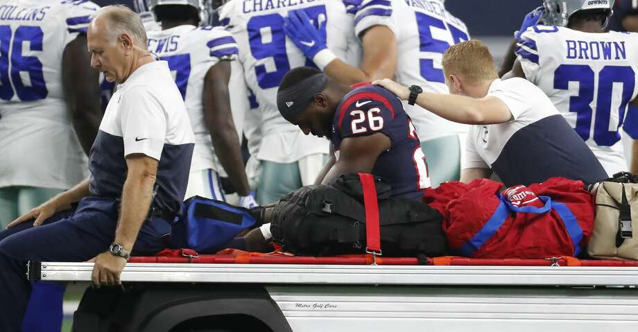 Houston Texans running back Lamar Miller (26) is carted off the field after suffering an injury against the Dallas Cowboys during the first quarter of an NFL preseason football game at AT&T Stadium on Saturday, Aug. 24, 2019, in Arlington, Texas. Photo: Brett Coomer/Staff Photographer