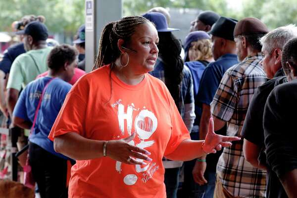 Marilyn Williams, Overflow Church co-pastor and director of outreach, talks with attendees waiting in line for a free meal during the second Hope for Homeless block party, put on by Overflow Church, at Discovery Green Saturday, Aug. 24, 2019 in Houston, TX. The event is an annual day of action where volunteers come together to draw attention to homelessness in the City Of Houston.