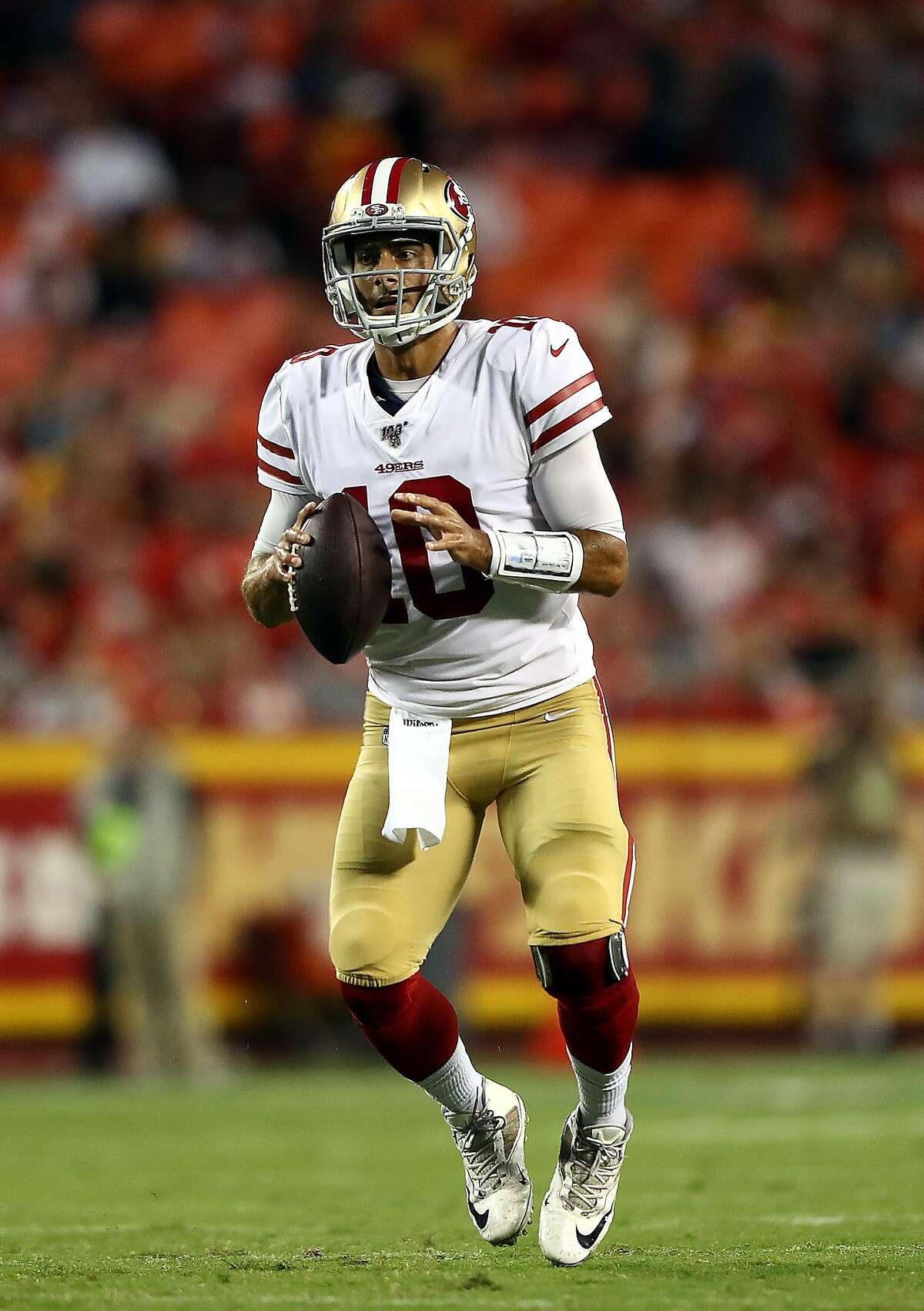 Quarterback Jimmy Garoppolo #10 of the San Francisco 49ers looks to pass during the preseason game against the Kansas City Chiefs at Arrowhead Stadium on August 24, 2019 in Kansas City, Missouri. (Photo by Jamie Squire/Getty Images)