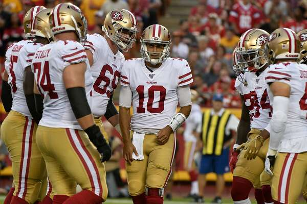 San Francisco 49ers quarterback Jimmy Garoppolo (10) stands with players during the first half of an NFL preseason football game against the Kansas City Chiefs in Kansas City, Mo., Saturday, Aug. 24, 2019. (AP Photo/Ed Zurga)