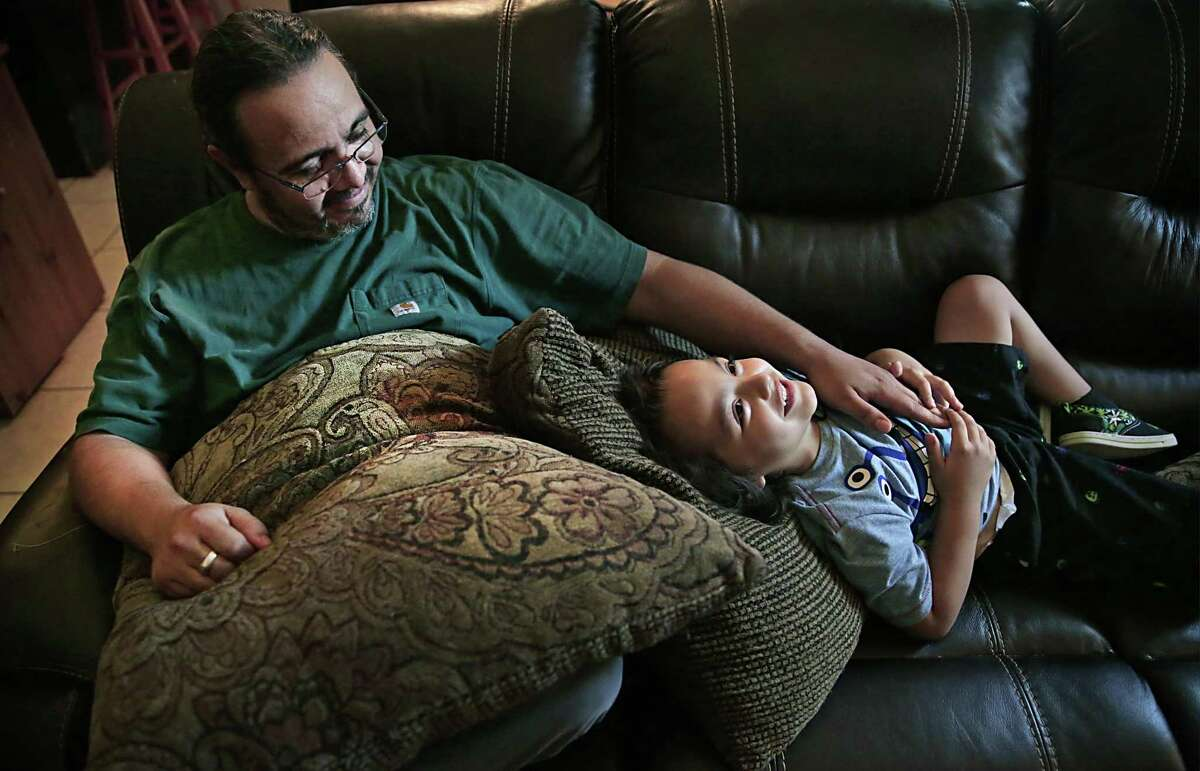 Ivan Mijares, left, plays with his son, also named Ivan, 5, after school.