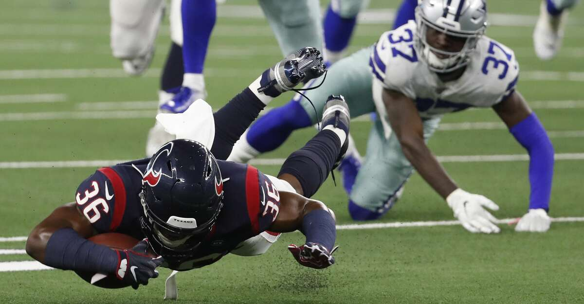 Houston Texans running back Damarea Crockett (36) is tripped up by Dallas Cowboys defensive back Donovan Wilson (37) during the second quarter of an NFL preseason football game at AT&T Stadium on Saturday, Aug. 24, 2019, in Arlington, Texas.