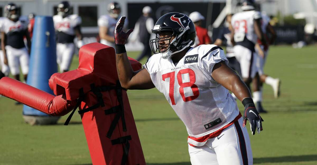Houston Texans nose tackle Javi Edwards goes through a drill during a joint NFL training camp football practice with the Detroit Lions Thursday, Aug. 15, 2019, in Houston. (AP Photo/David J. Phillip)