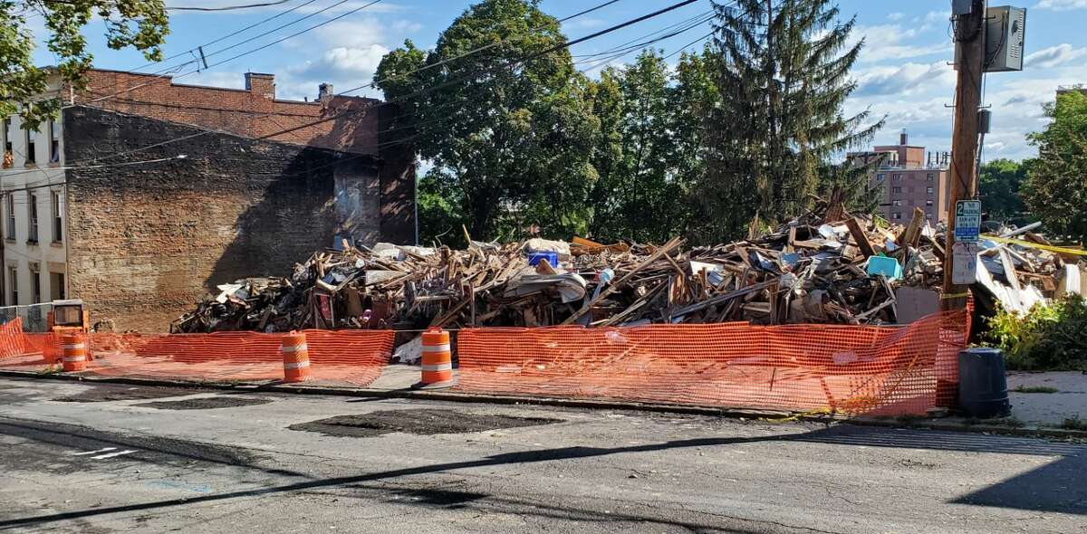 By Saturday afternoon, rubble was all that was left of five homes destroyed in a Friday morning fire on Myrtle Avenue in Albany. (Chris Churchill/Times Union)