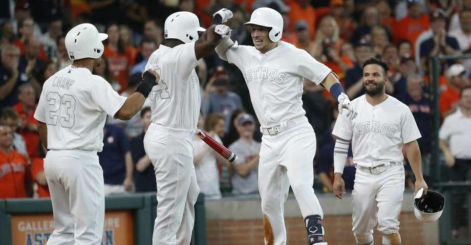 Houston Astros Alex Bregman (2) celebrates with Yordan Alvarez (44), and Michael Brantley (23) after hitting a three-run home run during the third inning of an MLB game at Minute Maid Park, Saturday, August 24, 2019. Photo: Karen Warren/Staff Photographer