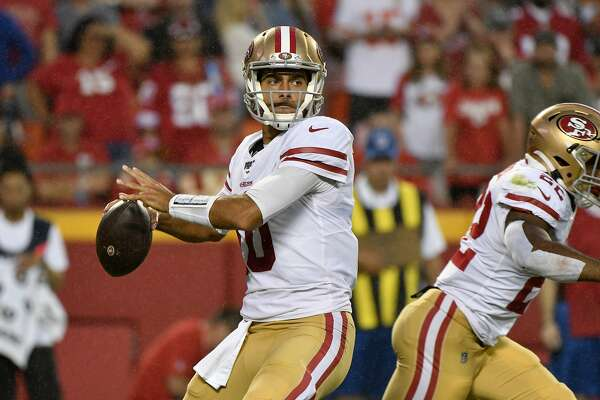 San Francisco 49ers quarterback Jimmy Garoppolo (10) looks to throw during the first half of an NFL preseason football game against the Kansas City Chiefs in Kansas City, Mo., Saturday, Aug. 24, 2019. (AP Photo/Ed Zurga)