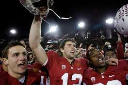 Stanford quarterback Andrew Luck, center, celebrates after defeating Oregon State 38-0 in an NCAA college football game in Stanford, Calif., Saturday, Nov. 27, 2010. (AP Photo/Paul Sakuma)