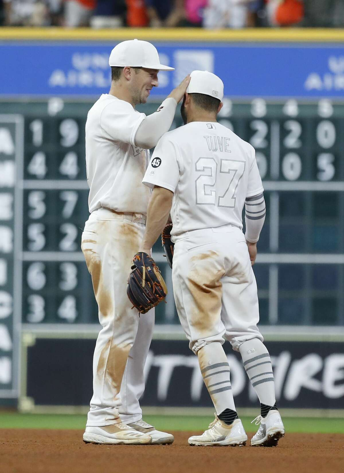 Houston Astros Alex Bregman (2) and Houston Astros Jose Altuve (27) celebrate the Astros win over the Los Angeles Angels 5-2 after the ninth inning of an MLB game at Minute Maid Park, Saturday, August 24, 2019.