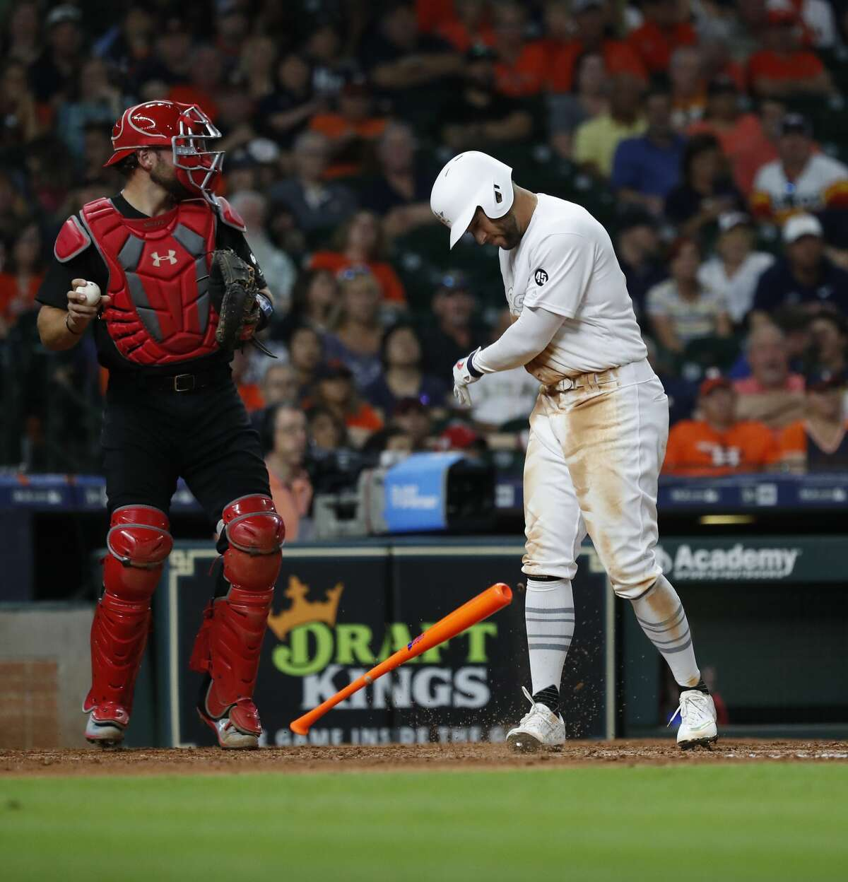 Houston Astros George Springer (4) slams his bat down after striking out to end the ninth inning of an MLB game at Minute Maid Park, Saturday, August 24, 2019.