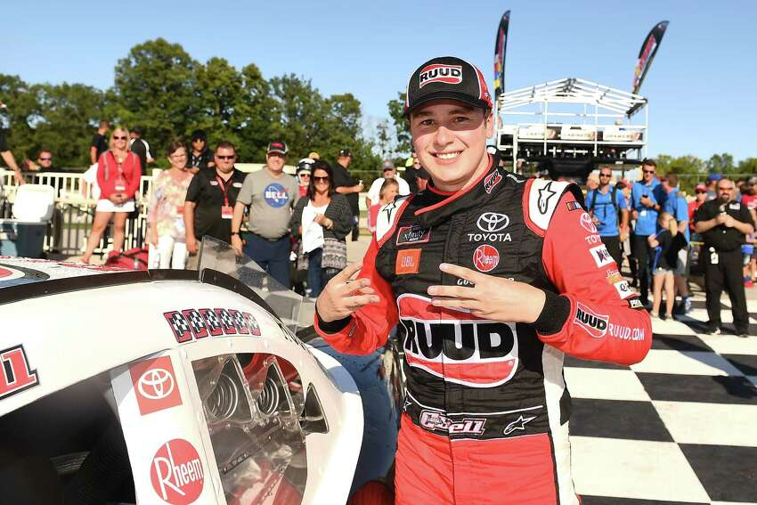 ELKHART LAKE, WISCONSIN - AUGUST 24: Christopher Bell, driver of the #20 Rudd Toyota, applies the winner's sticker after winning the NASCAR Xfinity Series CTECH Manufacturing 180 at Road America on August 24, 2019 in Elkhart Lake, Wisconsin. (Photo by Stacy Revere/Getty Images)