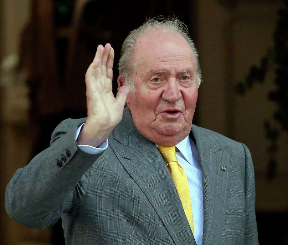 FILE - In this March 10, 2018, file photo, Spain's former monarch King Juan Carlos waves upon his arrival to the Academia Diplomatica de Chile, in Santiago where he met with President-elect Sebastian Pinera. Spain's former monarch, Juan Carlos I, has been admitted to hospital for a heart operation. The 81-year-old king emeritus will undergo the operation Saturday Aug. 24, 2019 in Madrid's Quiron clinic. (AP Photo/Esteban Felix, File) Photo: Esteban Felix / Copyright 2018 The Associated Press. All rights reserved.