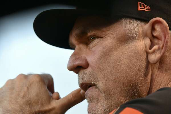 San Francisco Giants manager Bruce Bochy (15) looks on during the first inning of his teams game against then Chicago Cubs Tuesday, Aug. 20, 2019, in Chicago. (AP Photo/Matt Marton)
