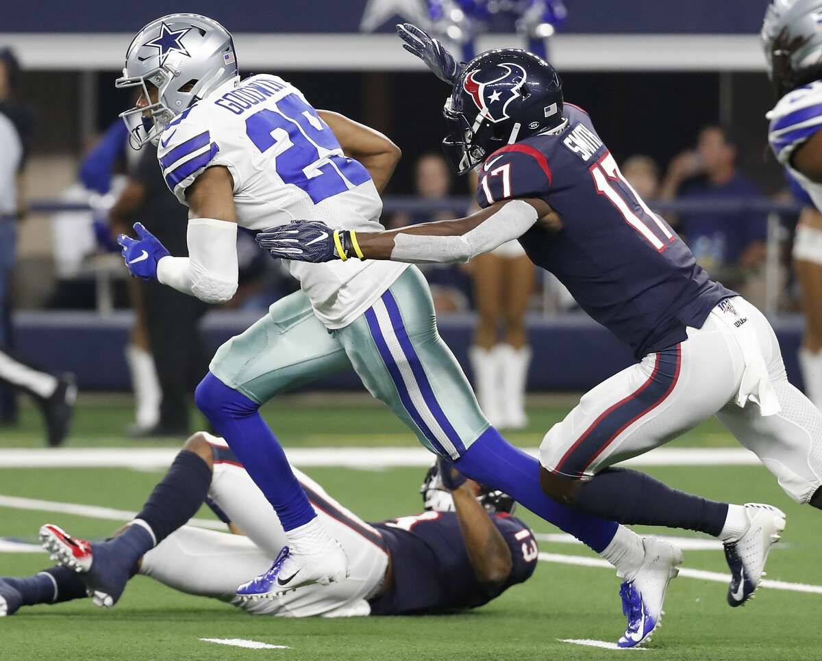 Dallas Cowboys defensive back C.J. Goodwin (29) is chased down by Houston Texans wide receiver Vyncint Smith (17) after Goodwin intercepted a pass during the second quarter of an NFL preseason football game at AT&T Stadium on Saturday, Aug. 24, 2019, in Arlington, Texas.
