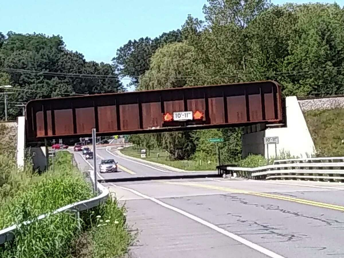 State Sen. Jim Tedisco and Glenville Town Supervisor Chris Koetzle have asked the state Department of Transportation to install safety signs near this Glenridge Road rail bridge to stop frequent truck bridge strikes. (photo provided)