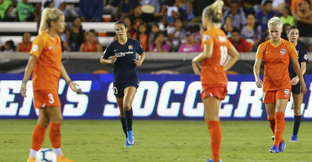 Sky Blue FC midfielder Carli Lloyd (10) walks back to her team's side of the field after scoring her second goal against the Houston Dash during the first half of an NWSL match at BBVA Stadium Saturday, Aug. 24, 2019, in Houston.