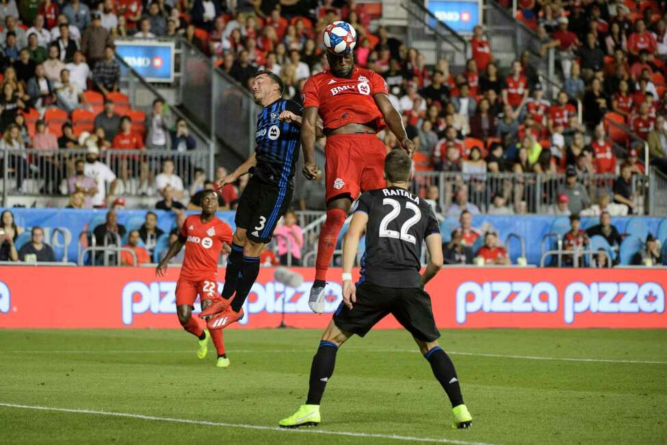Toronto FC forward Jozy Altidore (17) heads the ball against the Montreal Impact during second-half MLS soccer match action in Toronto, Saturday, Aug. 24, 2019. (Andrew Lahodynskyj/The Canadian Press via AP)