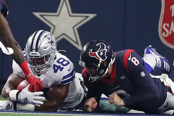 Dallas Cowboys linebacker Joe Thomas (48) falls on a loose ball in the end zone for a touchdown after he blocked a punt by Houston Texans punter Trevor Daniel (8) by during the first quarter of an NFL preseason football game at AT&T Stadium on Saturday, Aug. 24, 2019, in Arlington, Texas.