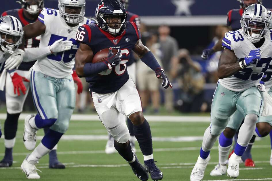 Houston Texans running back Damarea Crockett (36) runs the ball past Dallas Cowboys linebacker Justin March-Lillard (53) during the second quarter of an NFL preseason football game at AT&T Stadium on Saturday, Aug. 24, 2019, in Arlington, Texas.