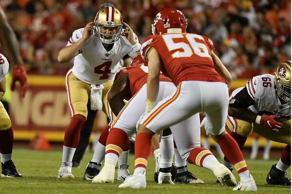 San Francisco 49ers quarterback Nick Mullens (4) calls a play at the line of scrimmage, as San Francisco 49ers defensive end Damontre Moore (56) watches, during the second half of an NFL preseason football game in Kansas City, Mo., Saturday, Aug. 24, 2019. (AP Photo/Ed Zurga)