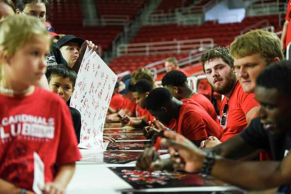 Fans get posters signed by Lamar athletes during Fan Day at the Montagne Center on Saturday. Photo taken on Saturday, 08/24/19. Ryan Welch/The Enterprise