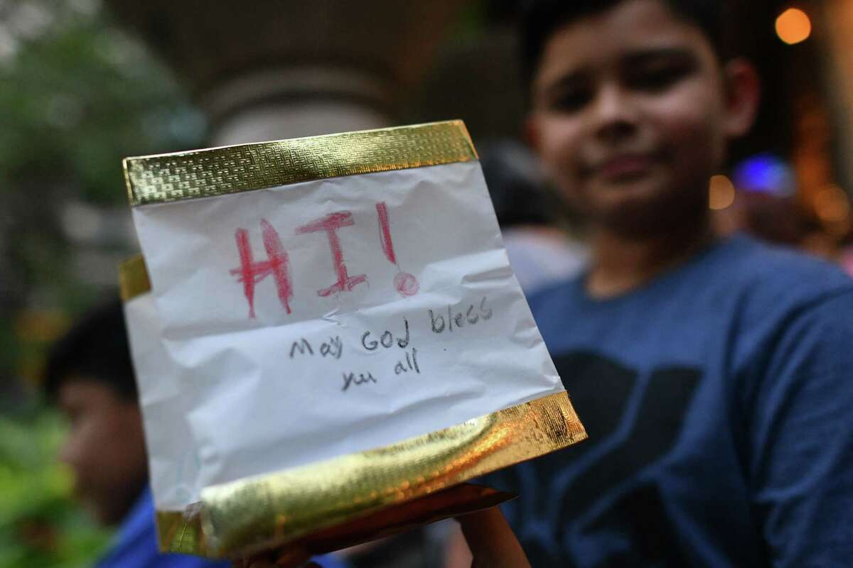 Isaiah Casanova, 11, shows his heartfelt message during the Wishing Lanterns event on the River Walk on Saturday, Aug. 24, 2019. The event is a way for people to remember loved ones and visualize their hopes and wishes.