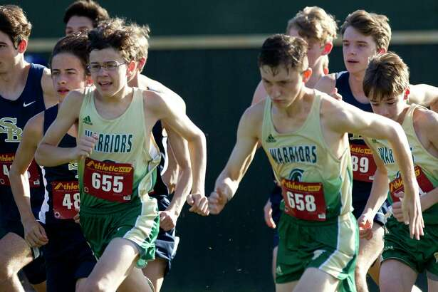 Members of The Woodlands Christian Academy boys cross country team compete in a cross country meet at The Woodlands Christian Academy, Saturday, Aug. 24, 2019, in The Woodlands.