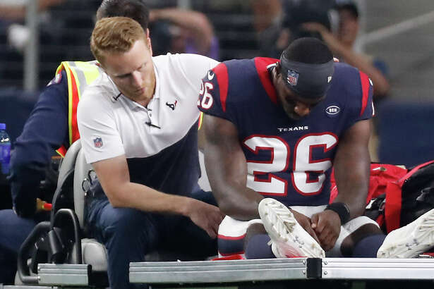 Houston Texans running back Lamar Miller (26) is carted off the field after suffering an injury against the Dallas Cowboys during the first quarter of an NFL preseason football game at AT&T Stadium on Saturday, Aug. 24, 2019, in Arlington, Texas.