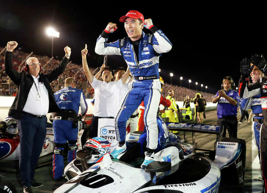 Takuma Sato celebrates after winning an IndyCar race at World Wide Technology Raceway on Saturday night in Madison. Photo: Associated Press