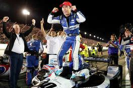 Takuma Sato celebrates after winning an IndyCar race at World Wide Technology Raceway on Saturday night in Madison.