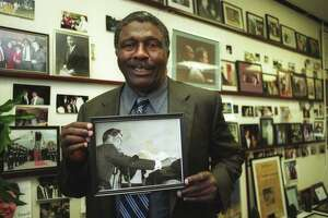 FILE PHOTO - / 11/7/03 Charles Tisdale holds a photo of John F. Kennedy at his office at ABCD in Bridgeport Nov. 7. Tisdale got the photo from Joe Kennedy in 1978 after seeing the picture in the Kennedy home and mentioning he liked it, so they gave it to him.