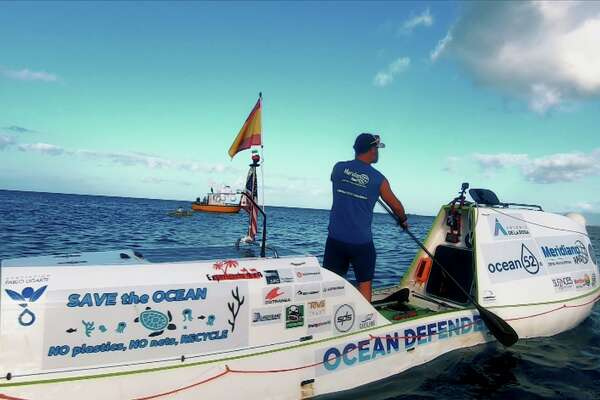 """His journey of self-described """"absolute loneliness and self-sufficiency"""" began in San Francisco on June 4. He paddled just over 2,900 miles to his Honolulu destination with the aim of raising awareness about protecting the ocean from man-made pollution."""