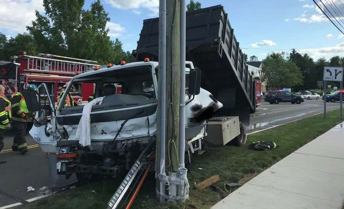 Monroe police, fire and EMS workers responded to an accident involving a dump truck on Aug. 24,2019.