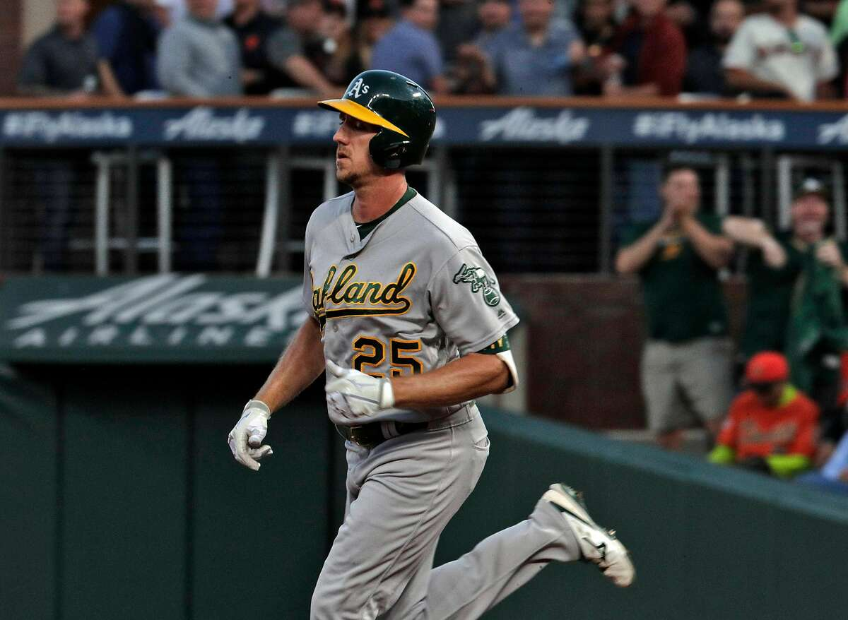 Stephen Piscotty (25) rounds the bases after hitting a solo homerun in the fifth inning as the San Francisco Giants played the Oakland Athletics at Oracle Park in San Francisco, Calif., on Tuesday, August 13, 2019.