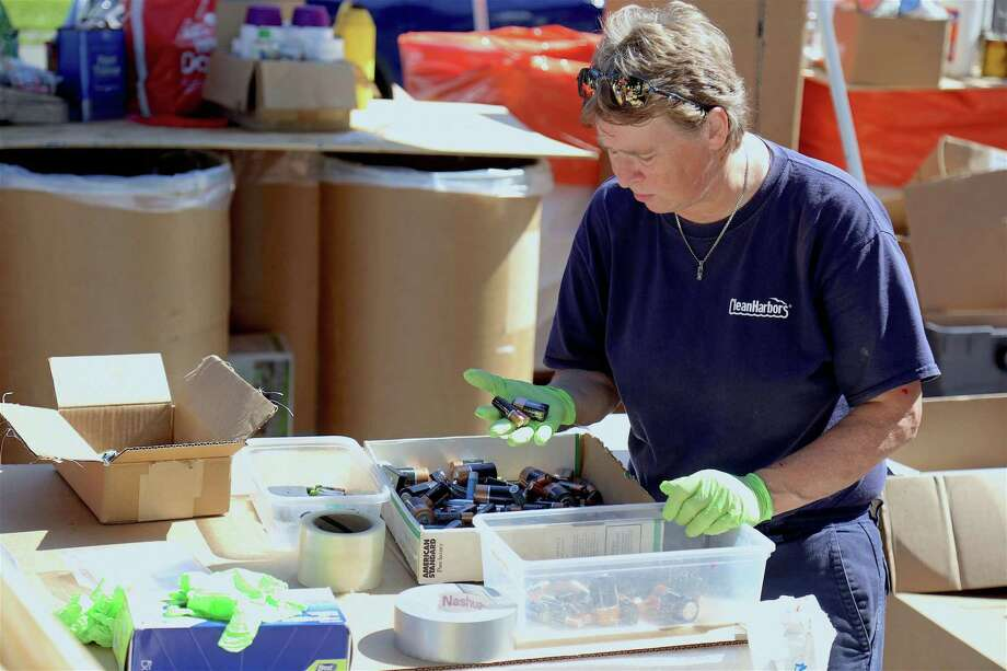 Alice Mackiewicz of Clean Harbors sorts through disposed of batteries at the annual Household Hazardous Waste Collection Day at Veterans Park on Saturday, Aug. 25, 2019, in Fairfield, Conn. Photo: Jarret Liotta / Jarret Liotta / ©Jarret Liotta