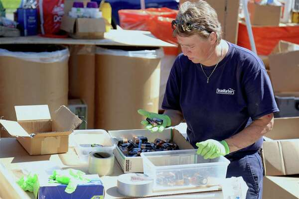 Alice Mackiewicz of Clean Harbors sorts through disposed of batteries at the annual Household Hazardous Waste Collection Day at Veterans Park on Saturday, Aug. 25, 2019, in Fairfield, Conn.