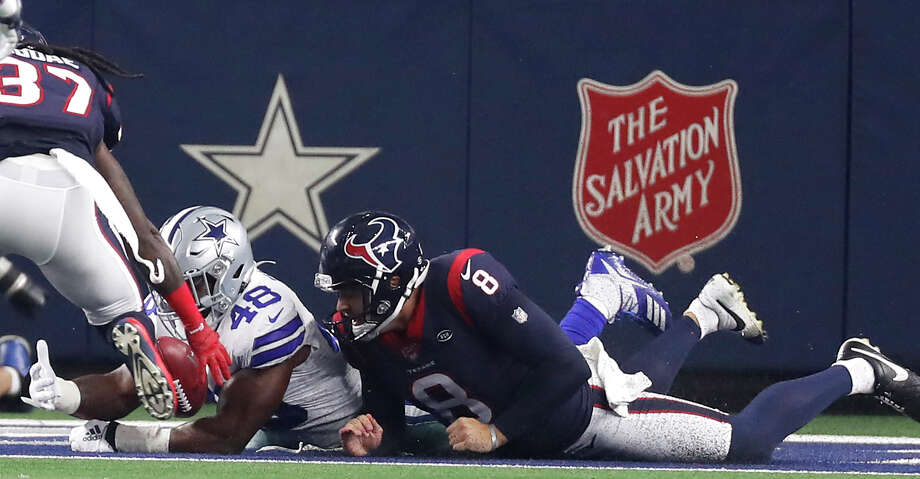 Dallas Cowboys linebacker Joe Thomas (48) falls on a loose ball in the end zone for a touchdown after he blocked a punt by Houston Texans punter Trevor Daniel (8) by during the first quarter of an NFL preseason football game at AT&T Stadium on Saturday, Aug. 24, 2019, in Arlington, Texas. Photo: Brett Coomer/Staff Photographer / © 2019 Houston Chronicle