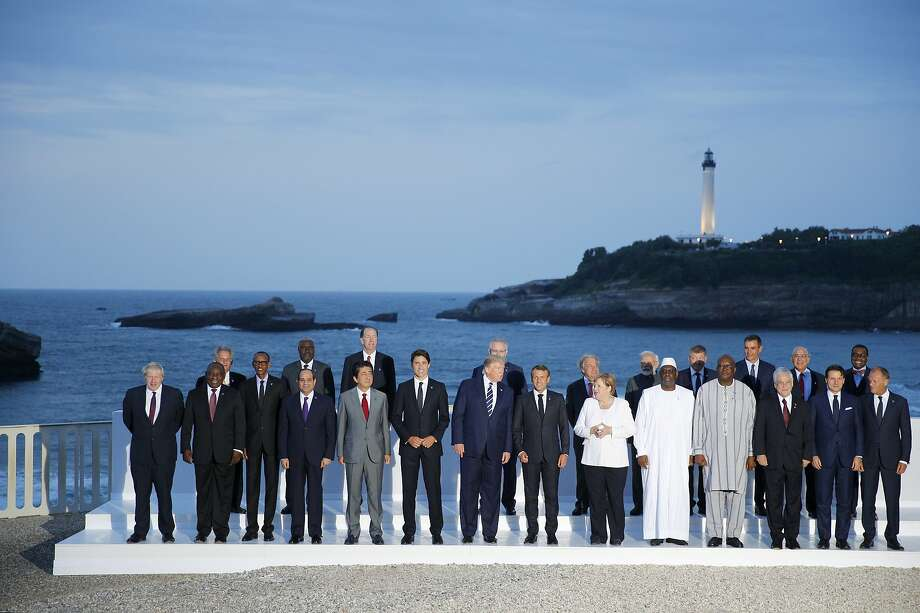 Group of Seven leader and guests pose for the G7 family photo Sunday, Aug. 25, 2019 in Biarritz. A top Iranian official paid an unannounced visit Sunday to the G-7 summit and headed straight to the buildings where leaders of the world's major democracies have been debating how to handle the country's nuclear ambitions. (AP Photo/Francois Mori) Photo: Francois Mori / Associated Press