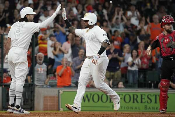 Houston Astros Martin Maldonado celebrates his home run with Jake Marisnick (6) during the seventh inning of MLB game against the Los Angels Angels at Minute Maid Park Sunday, Aug. 25, 2019, in Houston. Abraham Toro also scored on the home run.