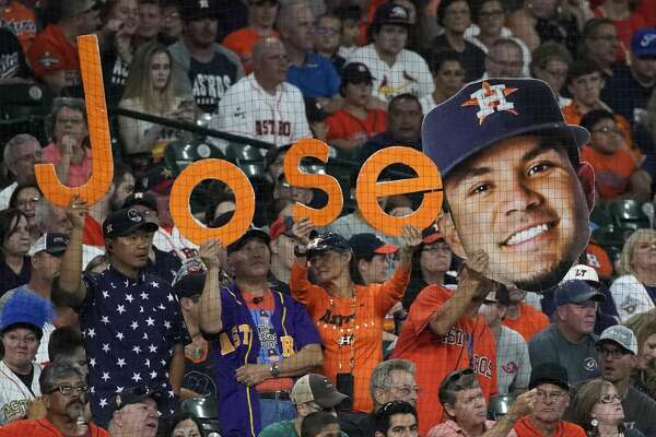 Fans display Jose Altuve signs during Houston Astros MLB game against the Los Angels Angels at Minute Maid Park Sunday, Aug. 25, 2019, in Houston.