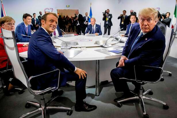 """France's President Emmanuel Macron (L) and US President Donald Trump attend a working session on """"International Economy and Trade, and International Security Agenda"""" in Biarritz, south-west France on August 25, 2019, on the second day of the annual G7 Summit attended by the leaders of the world's seven richest democracies, Britain, Canada, France, Germany, Italy, Japan and the United States. (Photo by Andrew Harnik / POOL / AFP)ANDREW HARNIK/AFP/Getty Images"""