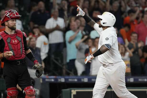 Houston Astros Martin Maldonado celebrates his home run against the Los Angels Angels during the seventh inning of MLB game at Minute Maid Park Sunday, Aug. 25, 2019, in Houston. Abraham Toro also scored on the home run.